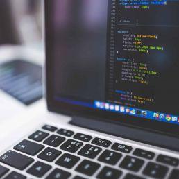Code on Laptop Screen - TypeEighty